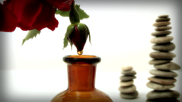 rose oil, - alternative medicine stock videos and b-roll footage