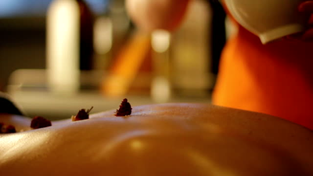 Rose petals put on skin by masseuse – slow motion video