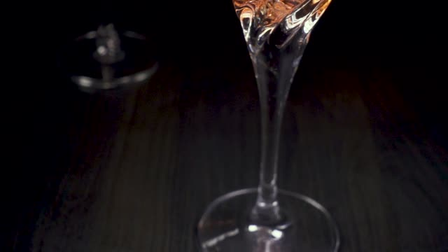 rose wine pours into a beautiful glass. camera goes up - decanter video stock e b–roll