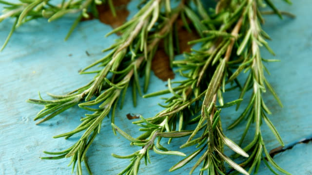 Rosemary on wooden table 4k video