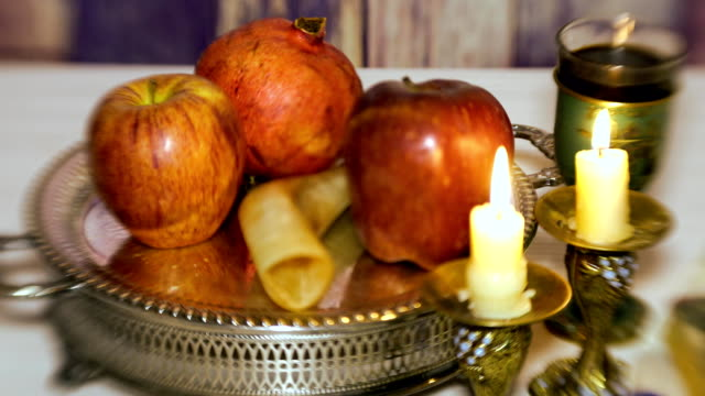 rosh hashanah jewish holiday concept: honey, apple and pomegranate, with space for text shofar and tallit selective soft focus - rosh hashana filmów i materiałów b-roll