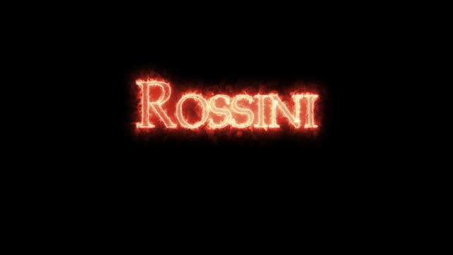 vídeos de stock e filmes b-roll de rossini written with fire. loop - compositor