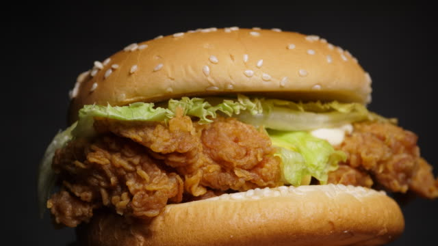Rotate motion hamburger chicken fried, Junk food concept - video