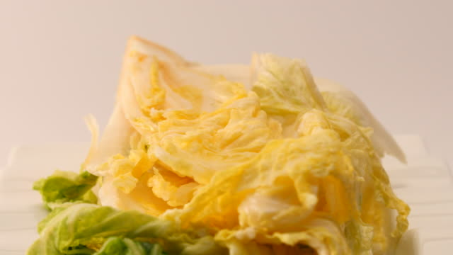 Rotate salt pickled cabbage for kimchi on a dish video