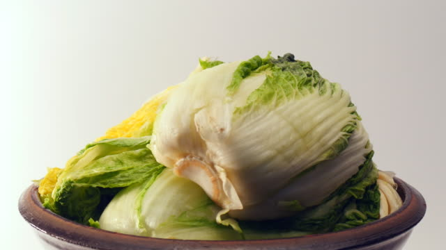 Rotate salt pickled cabbage for kimchi on crock video