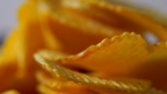 rotate/Potato fries, tableware Potato spicy delicious in a rotating dish. Potato fries, tableware Potato spicy delicious in a rotating dish potato chip stock videos & royalty-free footage