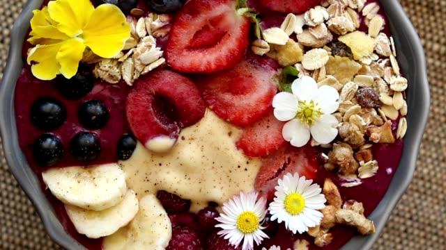 rotating acai berry bowl with fruits, close video