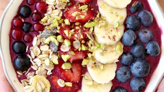 rotating acai berry bowl with fruits, close