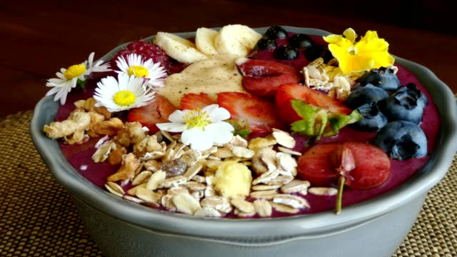 rotating acai berry bowl with fruits, close video
