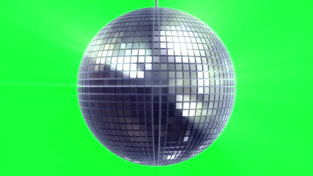 Rotating and glowing disco ball on green Rotating and glowing disco ball on green electric light stock videos & royalty-free footage