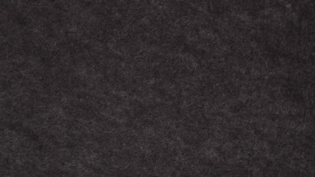 Rotating background of black felt video