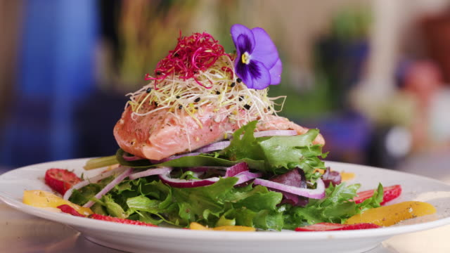 rotating beautifully prepared pink salmon salad - fine dining stock videos and b-roll footage