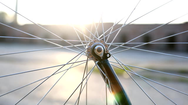 Rotating bicycle wheel