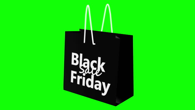 rotating black friday sale concept on black shopping bag on green screen - black friday стоковые видео и кадры b-roll