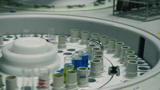 Rotating centrifuge with blood sample containers