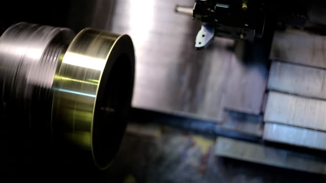 Rotating circular metal blank in a milling machine with CNC, closeup video