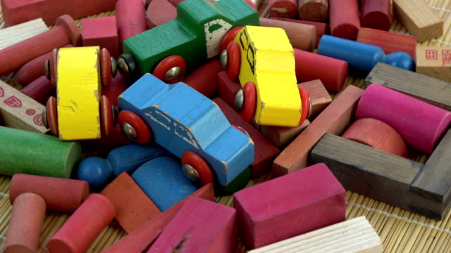 Rotating colorful wooden kids cars models and other toys video