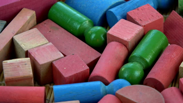 Rotating colorful wooden kids toys background video