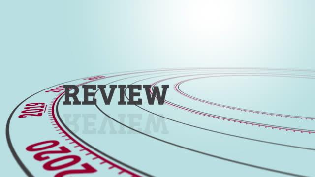 """rotating disc with text """"review"""" besides the number 2019 - sprawdzać filmów i materiałów b-roll"""