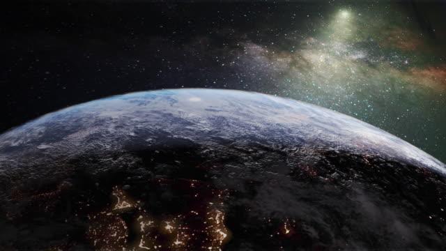 rotating earth with night lights and milky way - układ słoneczny filmów i materiałów b-roll