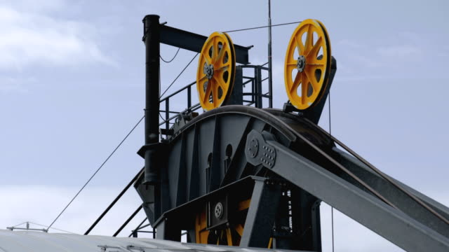 rotating gears wheel machine aerial tramway system mechanism detail close up driveline