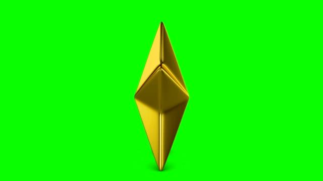 rotating golden star suitable for award ceremony or evaluation on green. - kształt gwiazdy filmów i materiałów b-roll