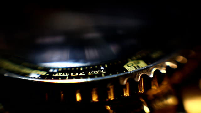 Rotating golden wristwatch with chronograph close up video