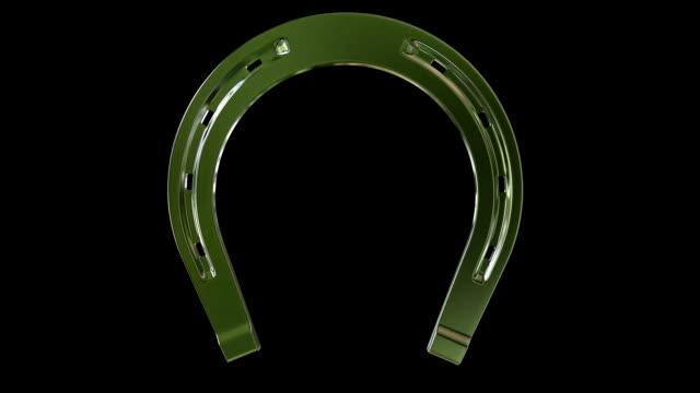 rotating horseshoe on black - horseshoe stock videos & royalty-free footage