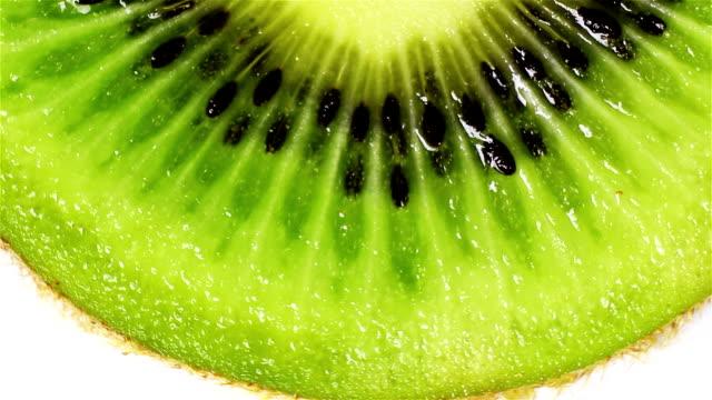 rotating kiwi slice, macro - kiwifrukt bildbanksvideor och videomaterial från bakom kulisserna
