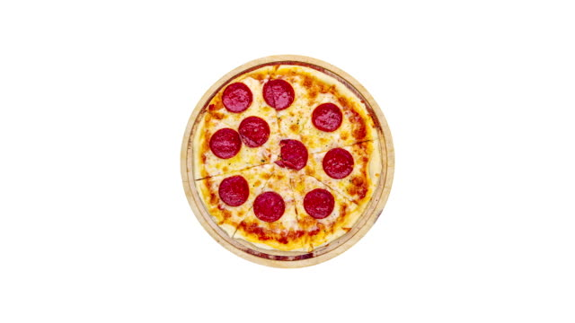 Rotating сlassic pepperoni pizza on a wooden stand isolated on a white background. Top view video
