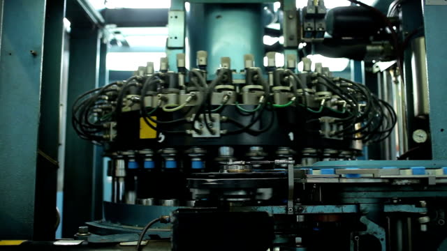 Rotating machine. Conveyor. Production Of Plastic bottle  Caps. video
