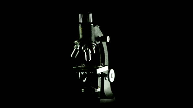 rotating microscope scientific research seamless looping background - science research stock videos & royalty-free footage