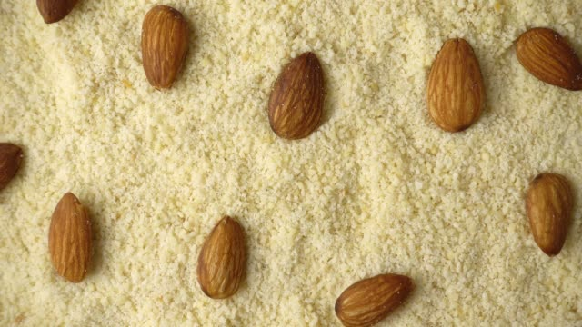 Rotating of almond flour, Almond nuts ground, 4K video