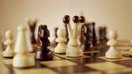 istock rotating old wooden chess pieces on a chessboard 1286355998