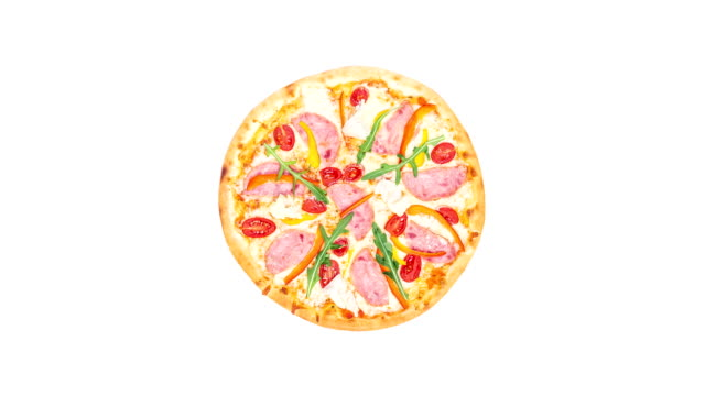 Rotating pizza with ham, sweet pepper, rucola, tomatoes and iceberg lettuce isolated on a white background. Top view video
