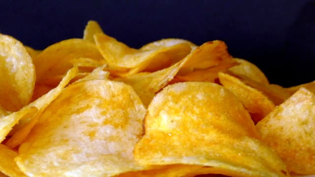 rotating potatoe chips - junk food stock videos and b-roll footage