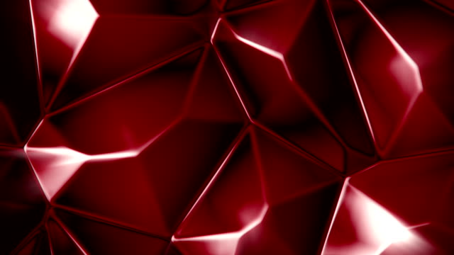 Rotating red crystals abstract background seamless loop video