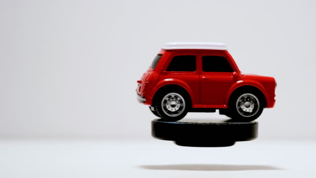 Izmir, Turkey - September 22, 2019. Rotating Red Toy car on a white background.