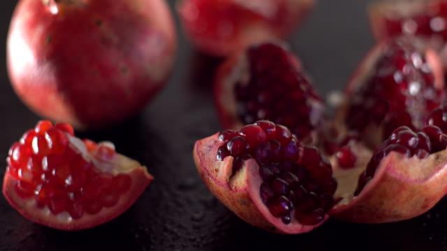Rotating ripe red garnet closeup. video