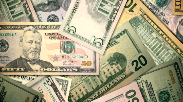 roterande skott av valuta i amerikas förenta stater - lön bildbanksvideor och videomaterial från bakom kulisserna