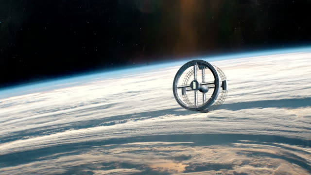 Rotating Space Station in Orbit of Planet Earth video