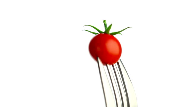 Rotating tomato on the fork video