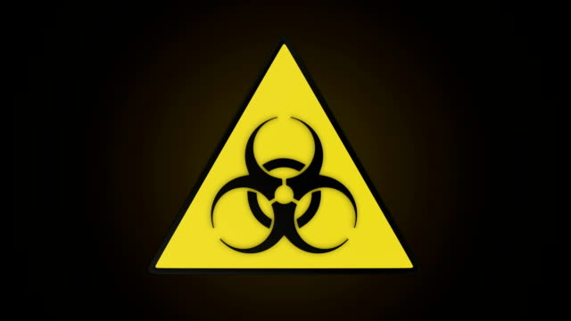 Rotating triangular biohazard sign. video