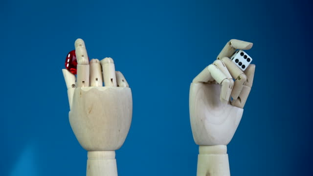 Rotating two wooden manikin hands with lucky dices Rotating two wooden manikin hands with lucky game dices marionette stock videos & royalty-free footage