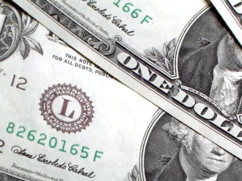 vídeos de stock e filmes b-roll de pal: rodar dólares dos eua (vídeo - acessório financeiro