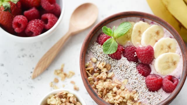 Rotating vegan acai smoothie bowl with superfood toppings video