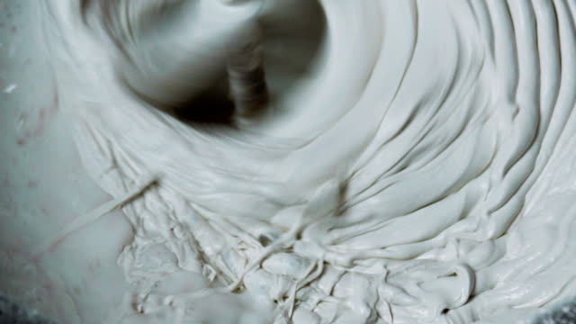 Rotating Whisk Mixer Immersed in Plaster Mix video