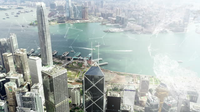 Rotating world Network connected loop lines. Hong Kong city background Aerial view.