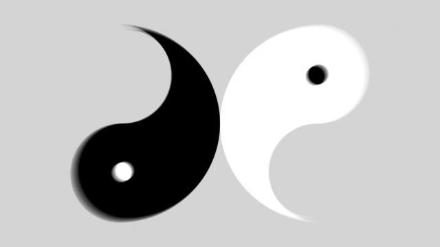 Rotating Yin Yang Symbol Black and white Yin Yang symbol. Rotates in separate halves. Shallow depth of field. Loops. Luma matte included. yin yang symbol stock videos & royalty-free footage