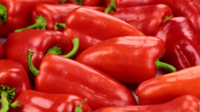 rotation, a heap of ripe pepper. texture of peppers. - paprica video stock e b–roll